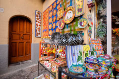 Colorful Ceramic Shop Display. Colorful glass trinkets displayed inside and outside a store Stock Photo