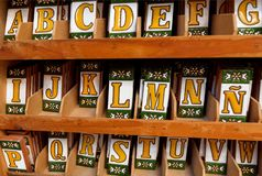 Colorful ceramic symbols of spanish alphabet inside souvenir shop of Andalusia. SEVILLE, SPAIN - NOV 16: Colorful ceramic symbols of spanish alphabet inside royalty free stock photo