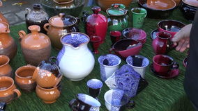 Colorful ceramics jugs and vases in fair. Colorful ceramics jugs and vases in street fair stock video