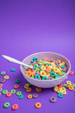Colorful cereal in bowl on a purple background Stock Photo