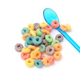 Colorful cereal and plastic spoon Stock Photos