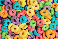 Colorful cereal  on a purple  background Royalty Free Stock Photos