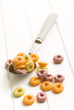 Colorful cereal rings in spoon Stock Image