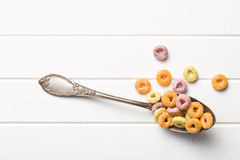 Colorful cereal rings in spoon Stock Images
