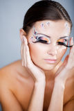 Colorful ceremonial makeup Stock Photos