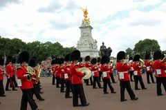 Changing Of Guard At Buckingham Palace, London, England. Also known as 'Guard Mounting', one regiment of the Queen's Guard takes over from another. The Stock Images