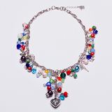 Colorful chain necklace with a silver heart Royalty Free Stock Images