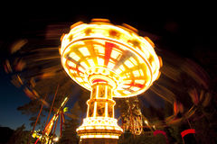 Free Colorful Chain Swing Carousel In Motion At Amusement Park At Night. Royalty Free Stock Photography - 98727827