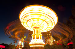 Free Colorful Chain Swing Carousel In Motion At Amusement Park At Night. Stock Photo - 98727930