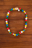 Colorful chain on wood, copy space Royalty Free Stock Photos