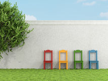 Colorful chair on grass Stock Photography