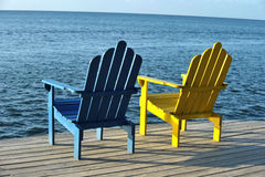 Colorful chair pair with picturesque ocean view Stock Images
