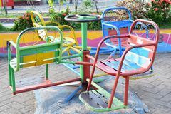 Colorful chairs in amusement park stock image