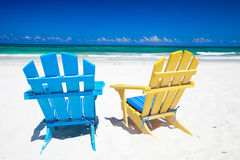 Colorful chairs on beach Stock Photos