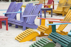 Colorful Chairs on the Beach. Colorful Adirondack Wooden Chairs on the Beach royalty free stock photo