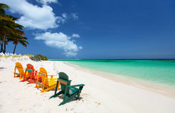 Colorful chairs on Caribbean beach Royalty Free Stock Image