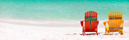 Colorful chairs on Caribbean beach Stock Photo