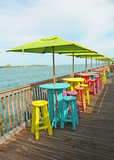 Colorful chairs overlooking ocean Stock Images