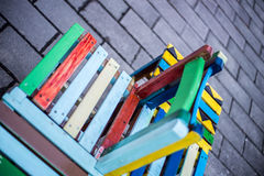 Colorful chairs on pavement Stock Photo