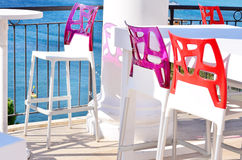 Colorful chairs in row in bar Royalty Free Stock Photos