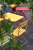 Colorful chairs in a street cafe Stock Image
