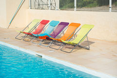 Colorful chairs at swimming pool Royalty Free Stock Photos