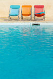 Colorful chairs at swimming pool Stock Images