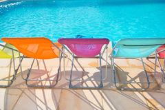 Colorful chairs at swimming pool Royalty Free Stock Image