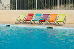 Colorful chairs at swimming pool Royalty Free Stock Images