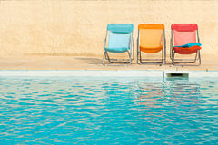 Colorful chairs at swimming pool Stock Photography