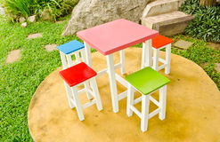 Colorful chairs and table Stock Images