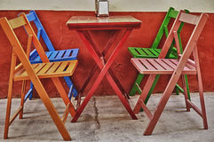 Colorful chairs and table Stock Photography