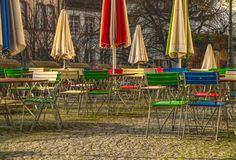 Chairs, tables and umbrellas in a garden of a restaurant royalty free stock photo