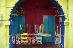 Colorful chairs on a wooden table Stock Image