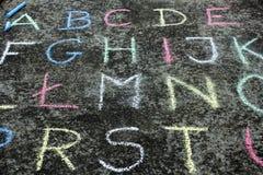 Colorful chalk on the asphalt, Stock Photos