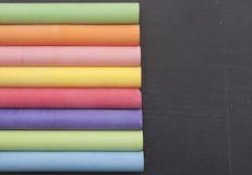 Colorful chalk. On a blackboard background with copy space for your text Stock Images