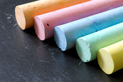 Colorful chalk on blackboard Stock Image