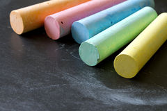 Colorful chalk on blackboard Royalty Free Stock Images