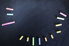 Colorful chalk on board royalty free illustration