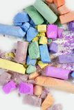 Colorful chalk broken colors mess over white Royalty Free Stock Photography