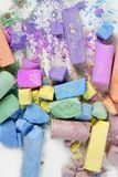Colorful chalk broken colors mess over white Stock Image