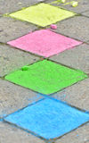 Colorful chalk colorings on pavement Stock Image