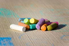 Colorful chalk on concrete Stock Photos