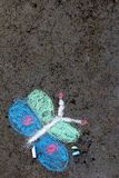 Colorful chalk drawing: beautiful butterfly. Colorful chalk drawing on asphalt: beautiful butterfly stock images