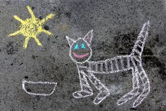 Colorful chalk drawing: funny cat. Colorful chalk drawing on asphalt: funny cat stock photos