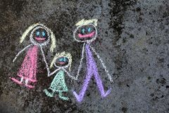 Colorful chalk drawing: happy family. Colorful chalk drawing on asphalt: happy family. Copy space royalty free stock image