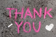 Chalk drawing: Pink words THANK YOU and small heart