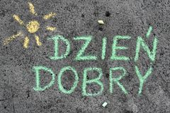 Chalk drawing: Polish words GOOD MORNING. Colorful chalk drawing on asphalt: Polish words GOOD MORNING stock photography
