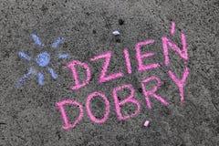 Chalk drawing: Polish words GOOD MORNING. Colorful chalk drawing on asphalt: Polish words GOOD MORNING royalty free stock photos