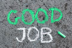 Chalk drawing : Words GOOD JOB and pieces of chalk. Colorful chalk drawing on asphalt: Words GOOD JOB and pieces of chalk stock photography